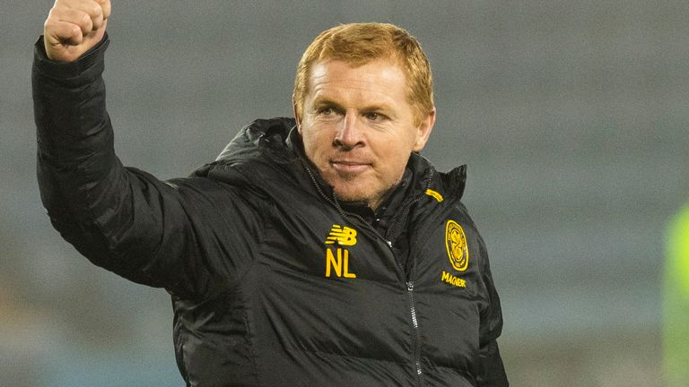 Neil Lennon salutes the Celtic supporters following his side's victory