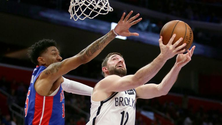 Joe Harris #12 of the Brooklyn Nets takes a shot against Christian Wood #35 of the Detroit Pistons during the second half at Little Caesars Arena on January 25, 2020, in Detroit, Michigan.