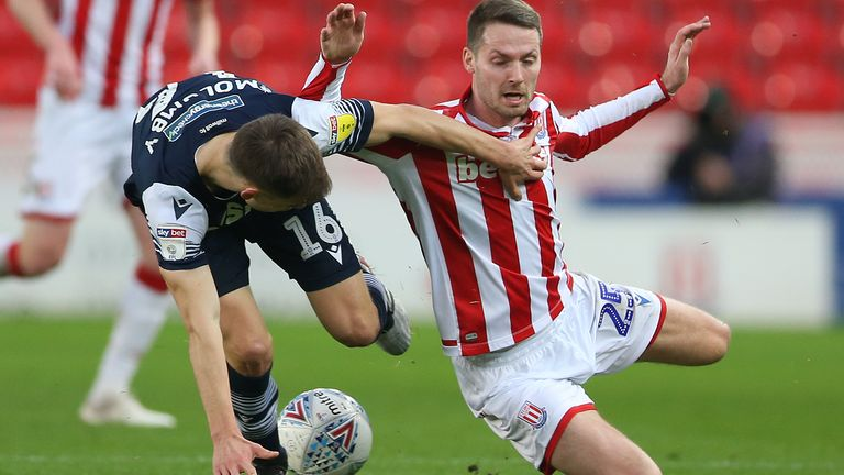 Stoke City's Nick Powell and Millwall's Jayson Molumby in action at the bet365 Stadium