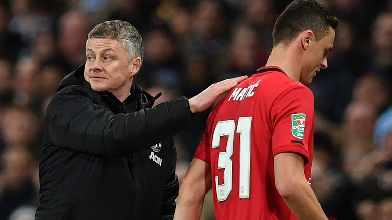 Ole Gunnar Solskjaer consoles Nemanja Matic after the Manchester United player's red card against Manchester City