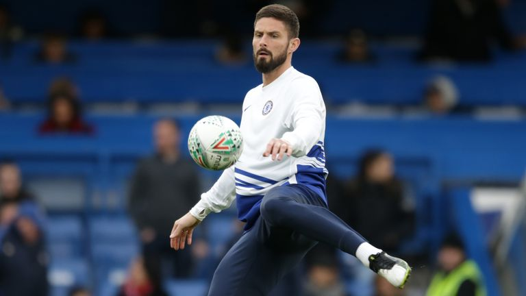 Olivier Giroud warms up ahead of an FA Cup tie against Nottingham Forest