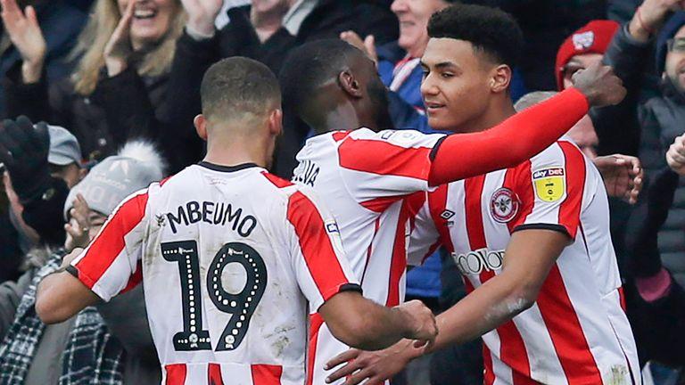 Ollie Watkins of Brentford celebrates with team-mates after scoring their third goal