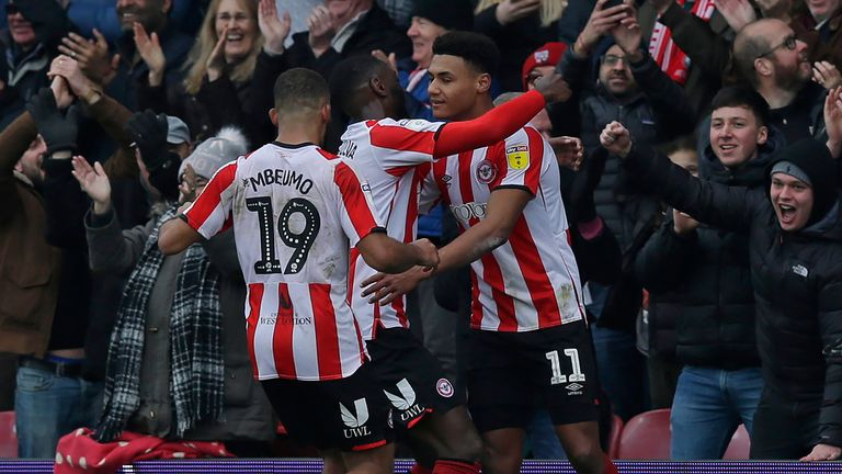 Ollie Watkins celebrates after scoring for Brentford against QPR