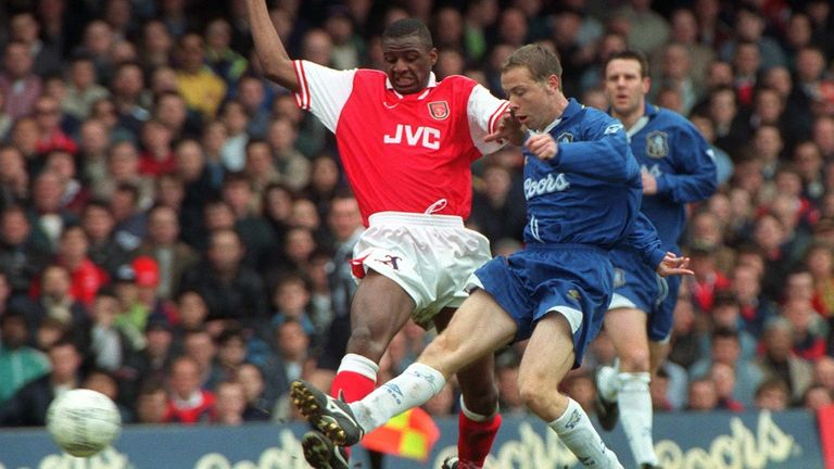 Chelsea's Paul Hughes competes for the ball with Arsenal's Patrick Vieira