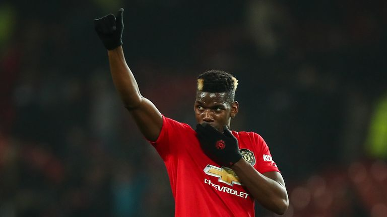 Paul Pogba of Manchester United waves to the fans at full time during the Premier League match between Manchester United and Newcastle United at Old Trafford on December 26, 2019 in Manchester, United Kingdom.