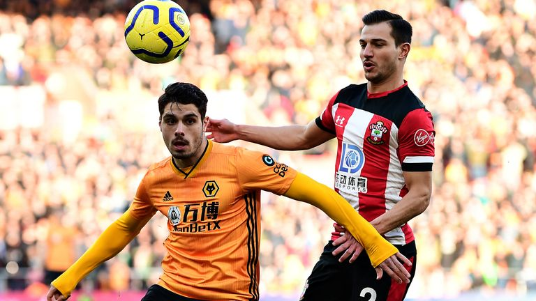 Pedro Neto and Cedric Soares in Premier League action at St Mary's Stadium