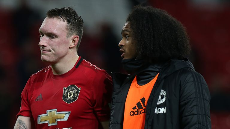 Phil Jones and Tahith Chong trudge off the Old Trafford pitch following the defeat