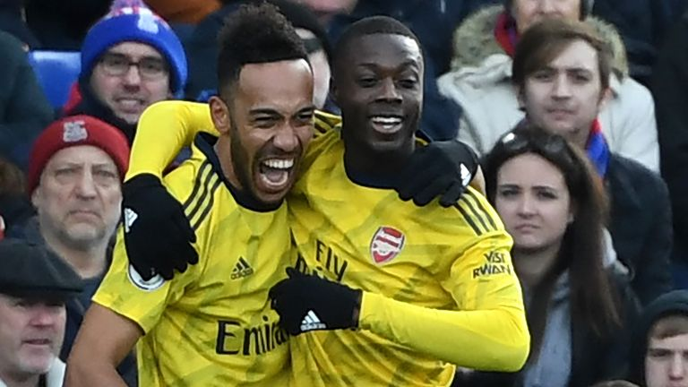 Pierre-Emerick Aubameyang celebrates his goal with Nicolas Pepe