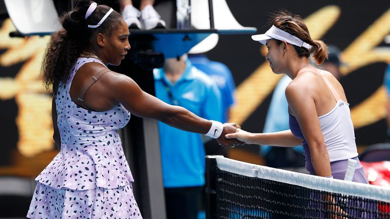 Williams is gracious in defeat as she shakes hands with Wang at the net