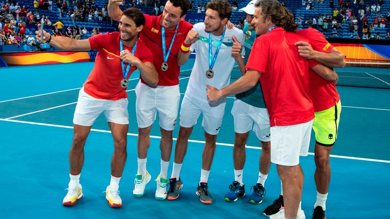 Rafael Nadal takes a team selfie after helping Spain qualify for the quarter-finals