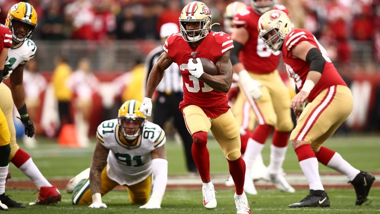 Raheem Mostert of the San Francisco 49ers breaks away to run for a touchdown in the first quarter against the Green Bay Packers during the NFC Championship game