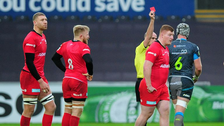 Rhys Carre of Saracens is shown a red card