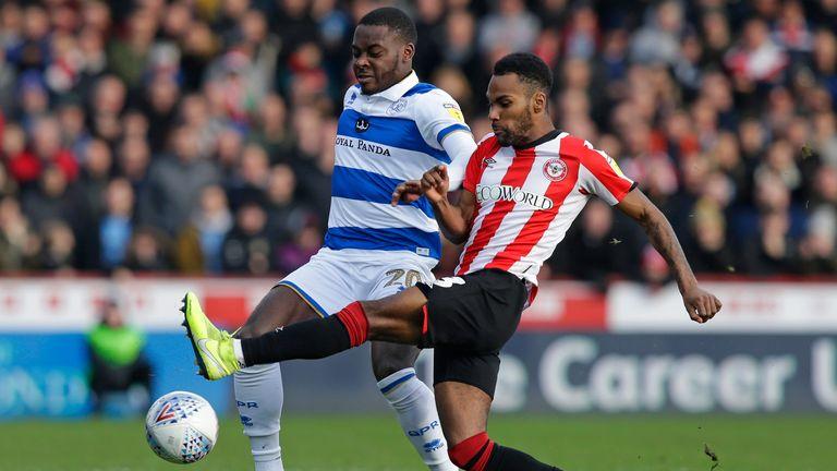 Brentford's Rico Henry challenges Bright Osayi-Samuel of QPR