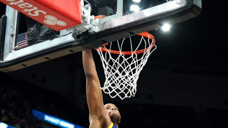 Omari Spellman #4 of the Golden State Warriors goes up for a dunk during a game against the Minnesota Timberwolves on January 2, 2020 at Target Center in Minneapolis, Minnesota.
