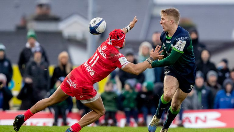 Connacht's Stephen Kerins looks to get a pass away despite the attentions of Cheslin Kolbe