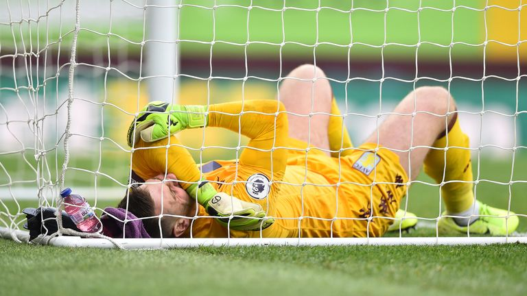 Tom Heaton lies on the turf after picking up an injury in the second half