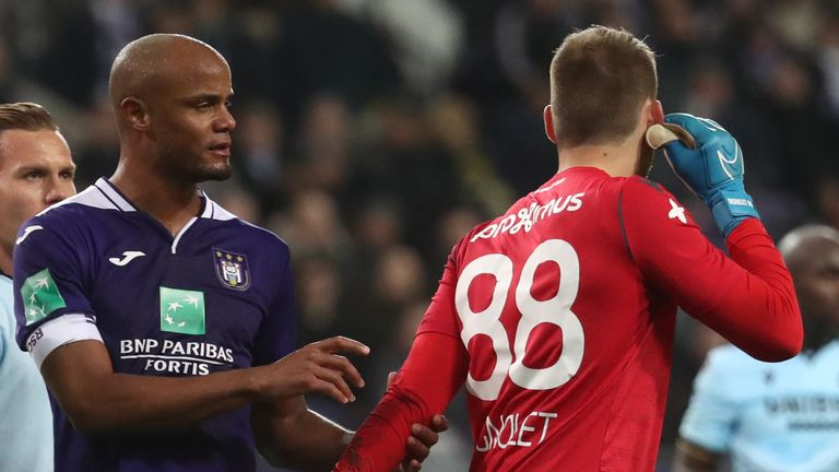 Vincent Kompany consoles Simon Mignolet after Anderlecht fans threw a flare at the Club Brugge goalkeeper