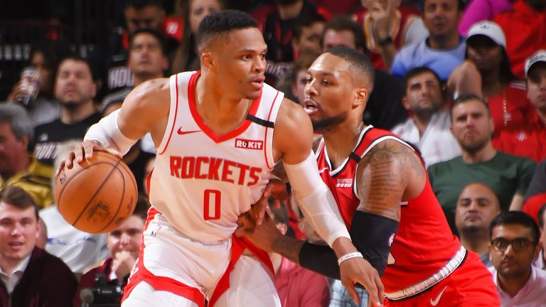 Russell Westbrook #0 of the Houston Rockets handles the ball against Damian Lillard #0 of the Portland Trail Blazers