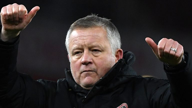 Chris Wilder salutes the Sheffield United fans after his side drew at Arsenal.