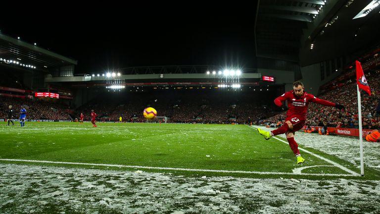 Xherdan Shaqiri takes a corner in the snow during Liverpool vs Leicester
