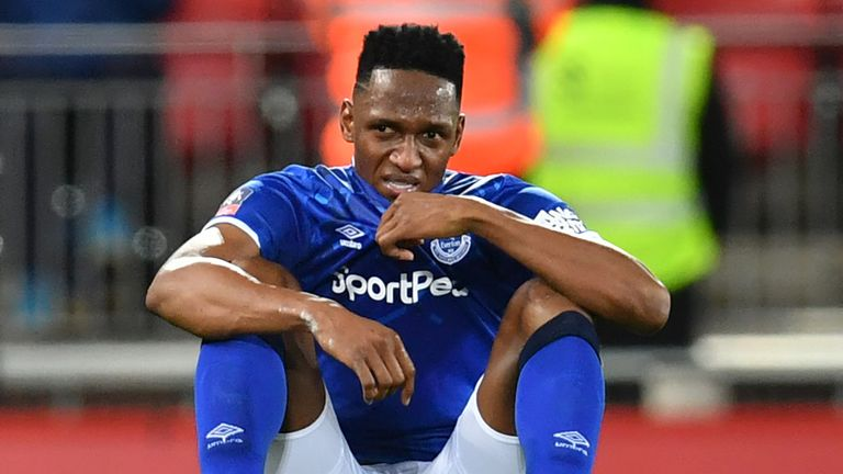 Yerry Mina slumps to the ground at the full-time whistle at Anfield