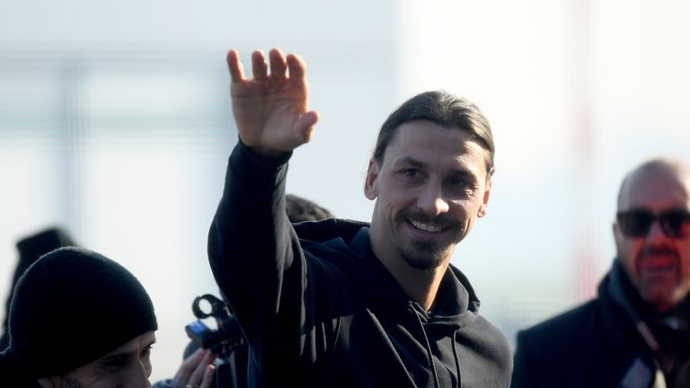 Newly appointed AC Milan forward Zlatan Ibrahimovic waves upon his arrival at Linate airport, on January 2, 2020. - Ibrahimovic has signed with AC Milan on a six-month deal, promising to help rescue the struggling Serie A outfit's season. The 38-year-old will undergo his medical on January 2 and will hold his first press conference the following day.