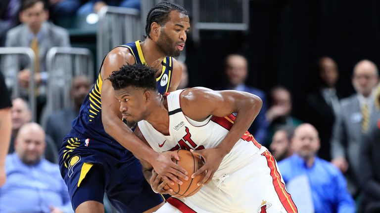 TJ Warren attempts to stop Jimmy Butler during the Pacers' loss to the Heat