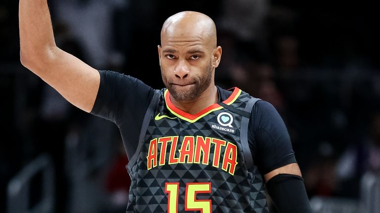 Vince Carter acknowledges the crowd after checking into the game