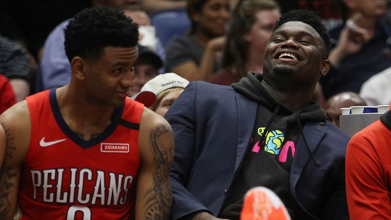 Zion Williamson shares a joke with Josh Hart on the Pelicans bench