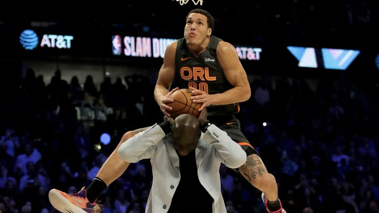 Aaron Gordon #00 of the Orlando Magic dunks the ball over Tacko Fall of the Boston Celtics in the 2020 NBA All-Star