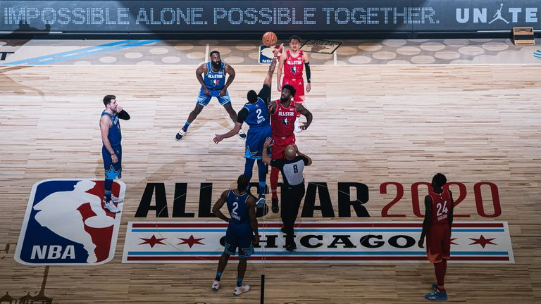 Joel Embiid of Team Giannis and Anthony Davis of Team LeBron reaches for the ball during the 69th NBA All-Star Game
