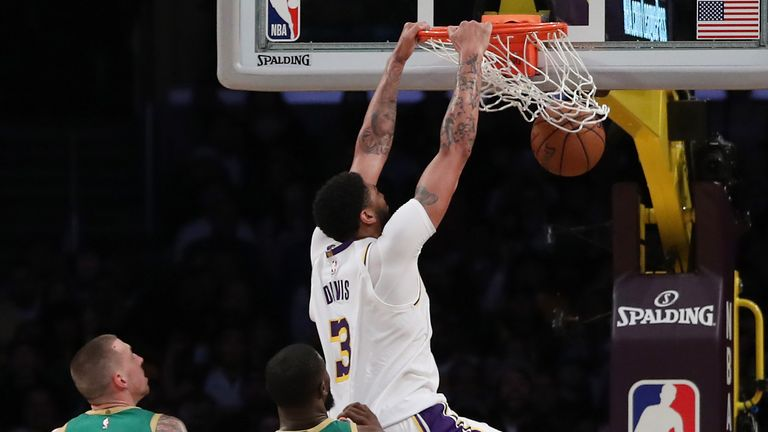 Anthony Davis of the Los Angeles Lakers dunks the ball during the third quarter against the Boston Celtics