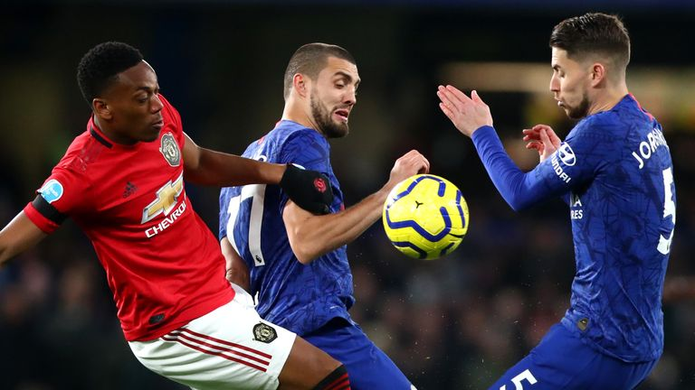 LONDON, ENGLAND - FEBRUARY 17: Anthony Martial of Manchester United and Mateo Kovacic and Jorginho of Chelsea FC in action during the Premier League match between Chelsea FC and Manchester United at Stamford Bridge on February 17, 2020 in London, United Kingdom. (Photo by Chloe Knott - Danehouse/Getty Images)