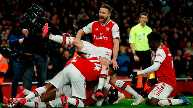 Mustafi celebrates with his Arsenal team-mates after their fourth goal against Newcastle last weekend