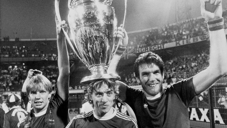 Aston Villa's Gary Shaw (left), Tony Morley (centre) and scorer of the winning goal Peter Withe (right) proudly show off the cup to the Villa fans in the Feyenoord Stadion. Villa beat Bayern Munich 0-1.