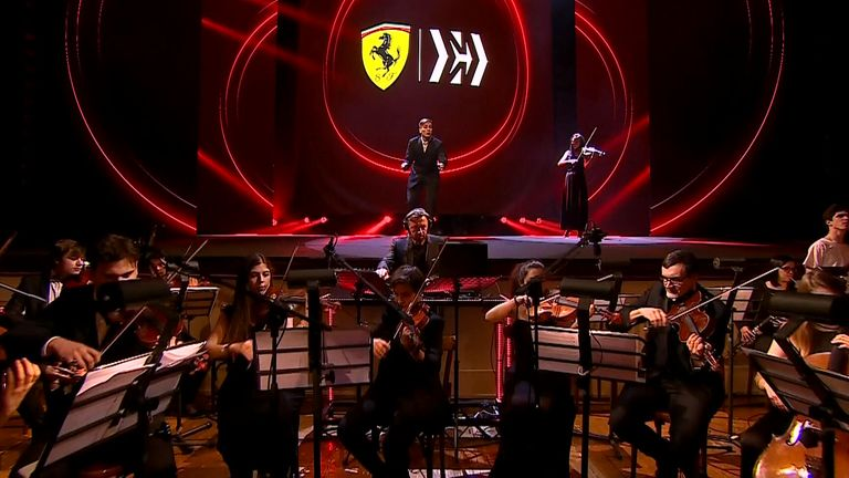 Ferrari's 2020 car launch gets underway in dramatic fashion as DJ Benny Benassi teams up with an orchestra and choir to perform an original score for the unveiling of the SF1000.