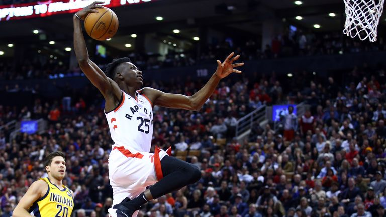 Chris Boucher of the Toronto Raptors dunks the ball during the second half of an NBA game against the Indiana Pacers