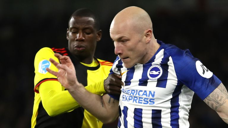 Aaron Mooy and Abdoulaye Doucoure battle for the ball