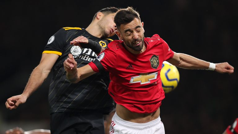 Bruno Fernandes and Raul Jimenez in Premier League action at Old Trafford