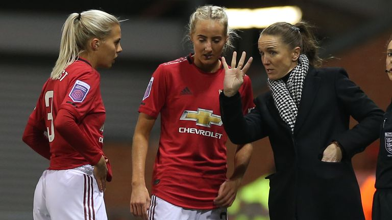Manchester United Women manager Casey Stoney speaks to Lottie Okvist and Millie Turner earlier in the season