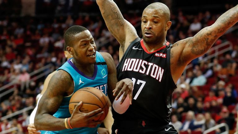 PJ Tucker protects the paint as Terry Rozier battles to the basket