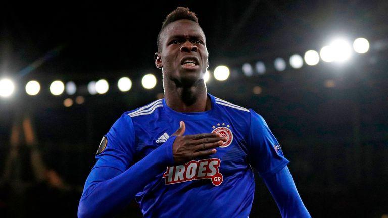 Olympiakos' Senegalese defender Cisse Abdou celebrates after scoring against Arsenal.