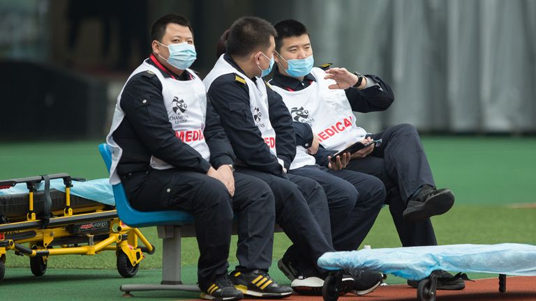 SHANGHAI, CHINA - JANUARY 28: Members of medical team wear masks during the AFC Champions League Preliminary Round match between Shanghai SIPG and Buriram United at Yuanshen Sports Centre Stadium on January 28, 2020 in Shanghai, China. Shanghai SIPG is playing Buriram United before an empty stadium due to the spread of the new coronavirus. (Photo by Yifan Ding/Getty Images)