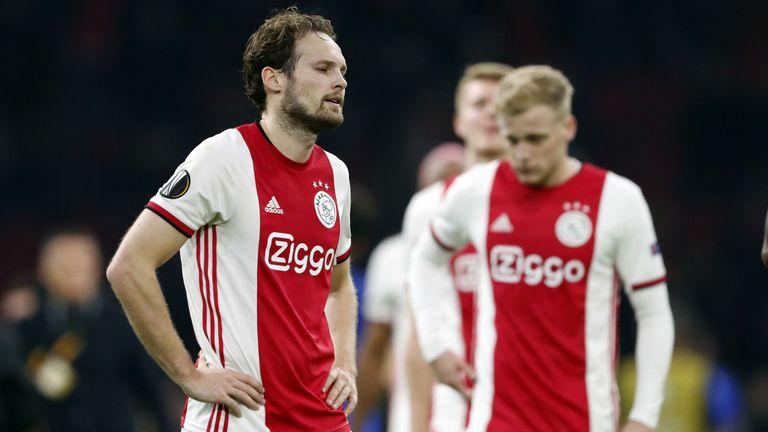 Daley Blind and Donny van de Beek of Ajax are dejected