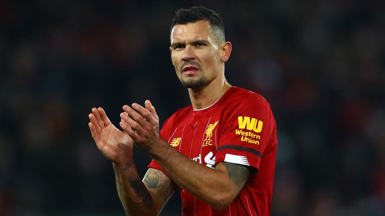 Dejan Lovren of Liverpool applauds the supporters following the Premier League match between Liverpool FC and Brighton & Hove Albion at Anfield on November 30, 2019 in Liverpool, United Kingdom.