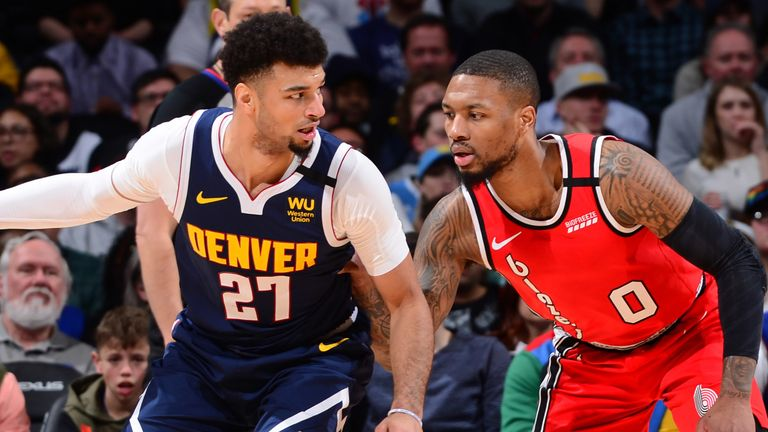 Jamal Murray backs down Damian Lillard