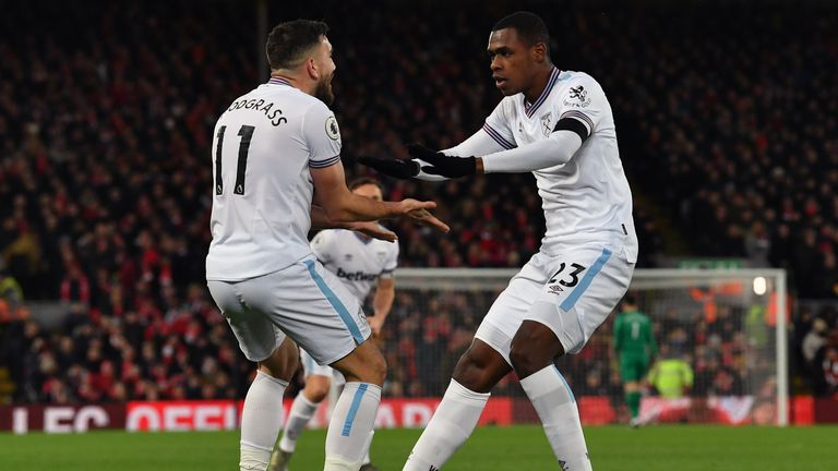 West Ham's Robert Snodgrass and Issa Diop celebrate their equaliser against Liverpool.