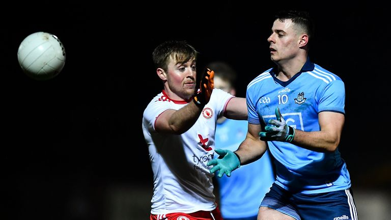 Brian Howard of Dublin in action against Michael O'Neill of Tyrone