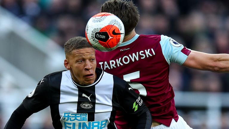 James Tarkowski and Dwight Gayle in action at St James' Park