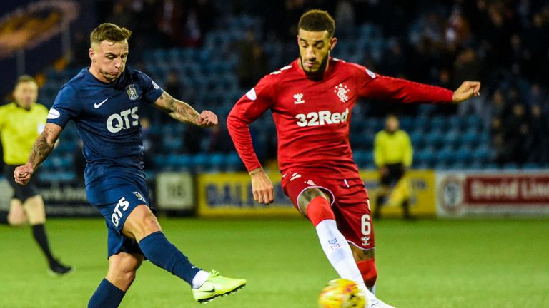 Eamonn Brophy escapes Connor Goldson to fire his shot into the bottom corner